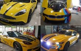 Siêu xe Aston Martin Vanquish cùng dàn xe thể thao tại Sài thành đồng loạt thay áo đề-can màu vàng