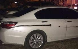 Quảng Ninh: Nhiều ô tô bị xịt sơn bẩn bằng câu chửi tục