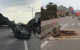 """Quảng Ninh: Tông vào dải phân cách, Mazda CX5 rụng bánh, """"ngửa bụng"""" trên phố"""