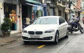 Xe sang Mercedes, BMW chết máy, nằm im lìm trên phố, mất cả gương khi chờ cứu hộ sau bão số 9