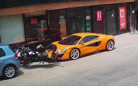 Biker hổ báo đền ốm vì đánh võng thẳng vào... siêu xe McLaren