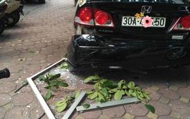 Honda Civic hứng trọn cửa kính chung cư rơi xuống, người dân hoang mang không hiểu nguyên nhân
