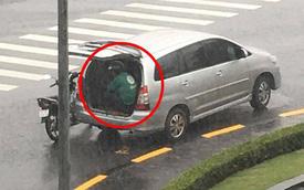 Cơn mưa bất chợt, tài xế Grab luống cuống tìm chỗ trú và hành động của chủ ô tô khiến tất cả kinh ngạc