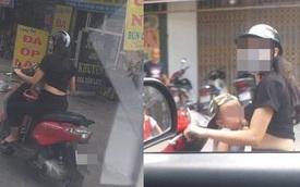 """Vừa lái xe vừa cho con trai bú, người phụ nữ khiến người đi đường """"toát mồ hôi lạnh"""""""