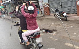 """Đôi vợ chồng """"kì quặc"""" và chi tiết trên chiếc xe máy khiến cả phố giật mình, sợ hãi"""