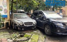 """Hà Nội: Xót xa nhìn Bentley, BMW tiền tỷ bị chủ nhân """"bỏ quên"""", chịu cảnh dầm mưa, dãi nắng"""