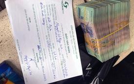 Tài xế trả lại 500 triệu đồng cho hành khách bỏ quên trên xe taxi