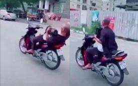 'Quái xế' 62 tuổi buông 2 tay phóng xe vèo vèo ở Hà Nội bị phạt 8,25 triệu đồng
