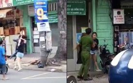 Dùng gậy sắt đập xe BMW, nam thanh niên bị nữ tài xế cầm ô rượt đuổi trên đường phố Sài Gòn