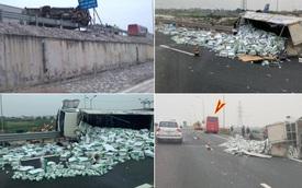 Xe tải bị lật nghiêng sau va chạm, hàng trăm thùng sữa văng trên đường