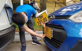 Xem xét giảm phí đổi biển số màu vàng cho xe kinh doanh