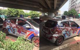 Đỗ xe đi ăn sáng, tài xế hốt hoảng khi thấy 'miếng cơm manh áo' bị xịt sơn kín mít