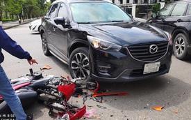 Đâm trúng Mazda CX-5, thanh niên vội vứt xe máy bỏ chạy - nhìn hiện trường, tất cả đều hiểu lý do