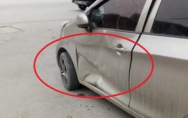 Lấy ô tô, tài xế hoảng hốt vì vết lõm lớn trước đầu xe, mảnh giấy người lạ để lại gây tò mò