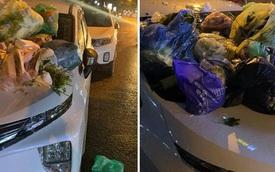 """Đỗ xe ngay ngắn sát mép sông, ô tô trắng bất ngờ biến thành """"bãi rác di động"""": Nguyên nhân gây tranh cãi"""