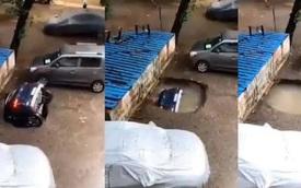 """Chiếc xe hơi đang trên đường bỗng nhiên bị """"nuốt chửng"""" xuống lòng đất khiến mọi người sợ hãi trước nguy cơ tiềm ẩn quen thuộc"""