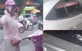 """""""Nữ ninja"""" cầm vật nhọn cào xước thân ô tô sau va chạm giao thông trên phố Hà Nội"""