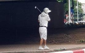 Tập golf ở chân cầu vượt, người đàn ông bị phạt 1 triệu đồng