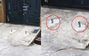 Chôn 2 cọc sắt trước cổng để bẫy xe lùi ké, chủ nhà khiến tất cả kinh hãi
