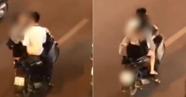 Clip: Đôi nam nữ gây bức xúc khi không đội mũ bảo hiểm, dừng xe máy giữa đường phố để… cãi nhau