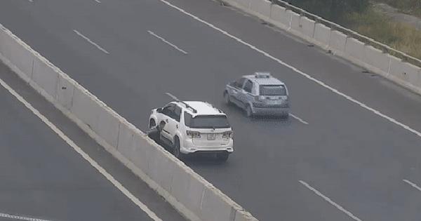 Clip: Nữ tài xế đỗ xe giữa cao tốc, liều mạng chạy băng qua đường để chụp ảnh sống ảo cho bạn trai